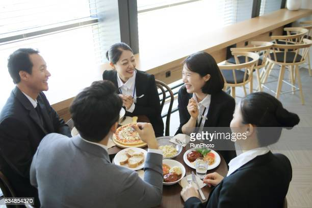 scene where businessmen talking while eating in a restaurant