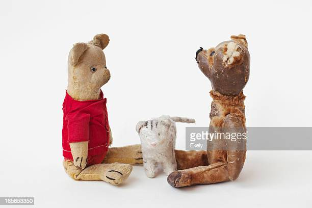 Scene with two vintage teddy bears and toy cat.