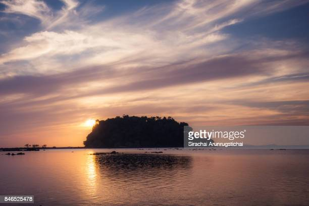 Scenery of an island under beautiful sunset sky by the sea