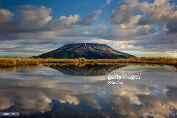 Scenery with Mount Taranaki reflecting in water, South Island, New Zealand