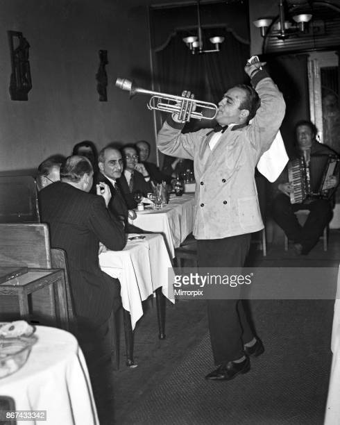 Scenes at Cafe Bleu restaurant in Soho London Musicians playing to customers seated at their tables 1st November 1951