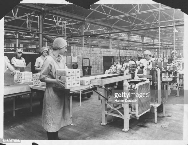 Scenes at the biscuit factory of W R Jacob Co Ltd at Aintree Liverpool Cream crackers being automatically wrapped in moistureproof halfpound cartons...