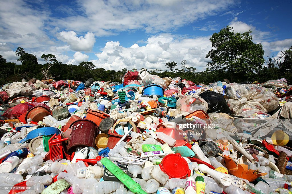 Scenes from a large plastic dumping ground cum primitive recycling area on the road from the Peruvian city of Iquitos to the town of Nauta located...