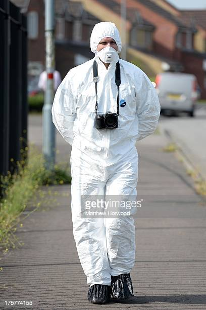 Scenes of Crime Officer walks down Willenhall Street close to the scene where a man and a woman are thought to be seriously injured after shots were...