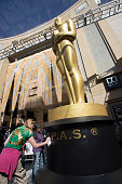 Scenic artists Dena DÕAngelo and Virginia Belloni affix the initials of the Academy of Motion Picture Arts and Sciences to the primary Oscar statue...