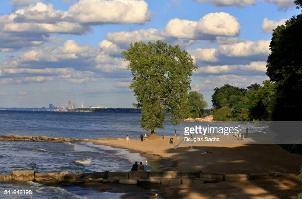 Scenic Beach on the Lake Erie Shore in the foreground with the Cleveland city skyline