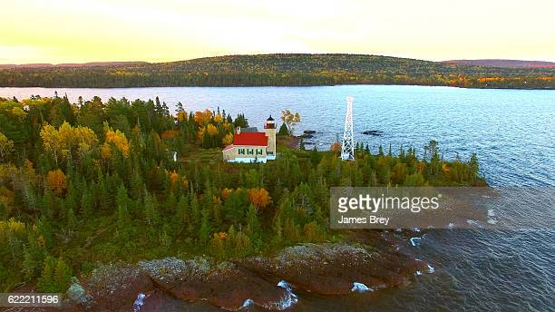 Scenic Copper Harbor Michigan lighthouse with Autumn colors, at dawn