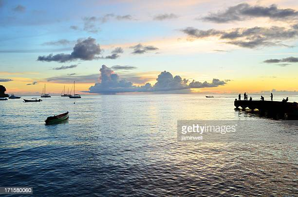 scenic exotic sunset with pier and boats