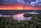 Scenic landscape with sunrise and lake at summer in national park Aulanko, Hämeenlinna, Finland