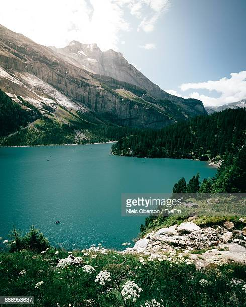 Scenic Shot Of Calm Countryside Lake Against Mountain Range