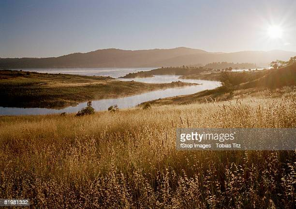 Scenic shot of fields, river and a mountain
