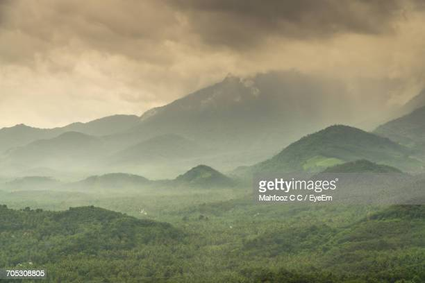 Scenic Shot Of Mountain Range In Foggy Weather