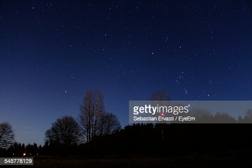Scenic Shot Of Stars Over Silhouette Landscape At Night