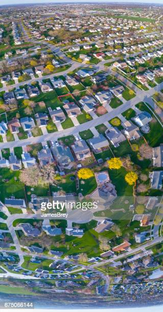 Scenic suburban neighborhood, aerial view early morning in Springtime.