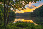 Dramatic evening light from along the lush shoreline of Cranks Creek Lake in the Southern Appalachian Mountains of Kentucky
