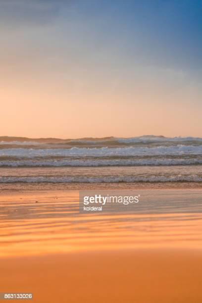 Scenic sunset on empty Mediterranean beach during stormy winter evening