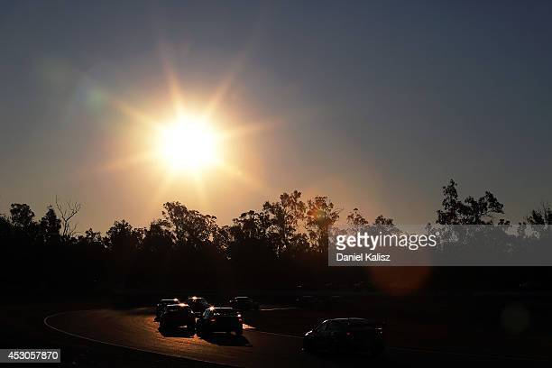 Scenic sunset race action during race 24 for the Ipswich 400 which is round eight of the V8 Supercar Championship Series at Queensland Raceway on...