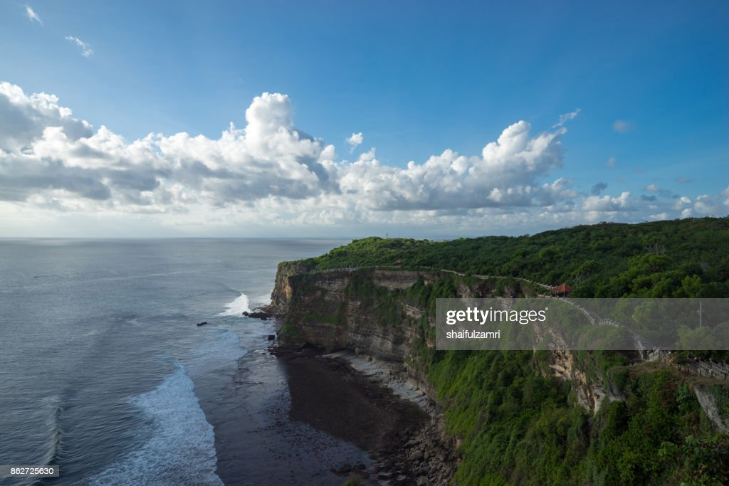 A scenic Uluwatu cliff with pavilion and blue sea in Bali, Indonesia. : Stock Photo