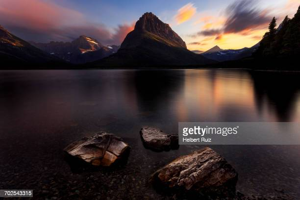 Scenic view at sunset, Swiftcurrent Lake, Glacier National Park, Montana, USA