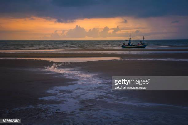 Scenic View Boat Moored on Beach Against Sky During Sunrise