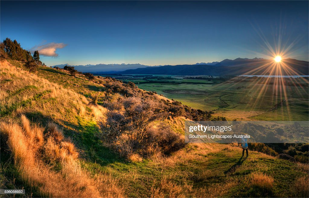 Scenic view near Te-Anau in the late afternoon, with Autumn colour display,  South Island, New Zealand
