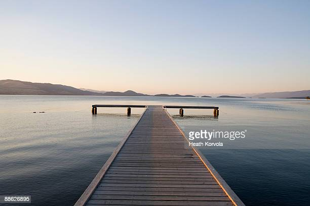Scenic view of a dock with sunset approaching.