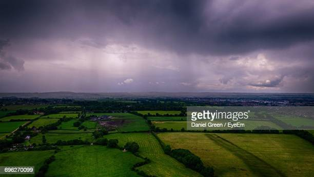 Scenic View Of Agricultural Field Against Sky At Night