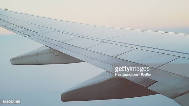 Scenic View Of Aircraft Wing Through Window