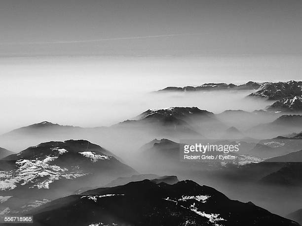 Scenic View Of Alps Mountains In Foggy Weather