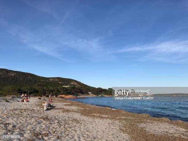 Scenic View Of Beach Against Blue Sky During Sunny Day