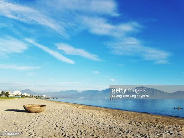 Scenic View Of Beach Against Blue Sky
