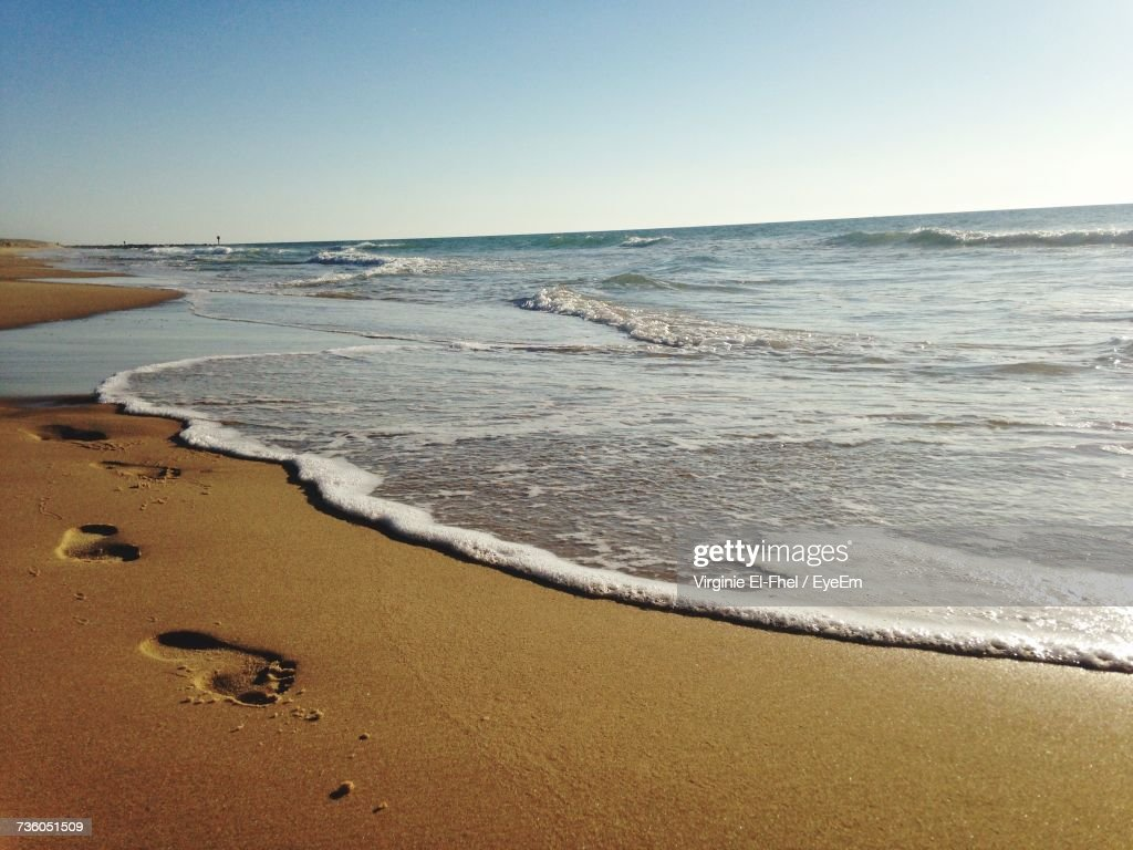 Scenic View Of Beach Against Clear Sky : Photo