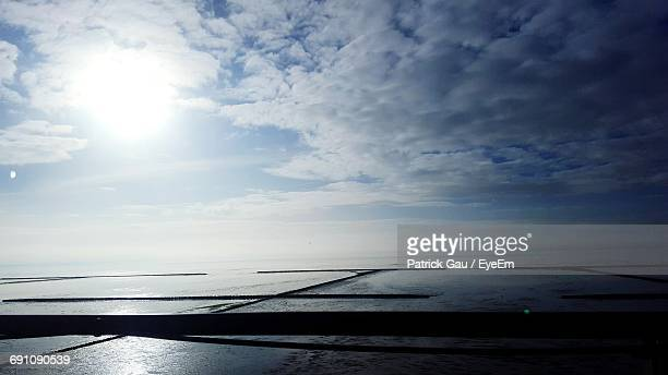Scenic View Of Beach Against Sky During Sunny Day