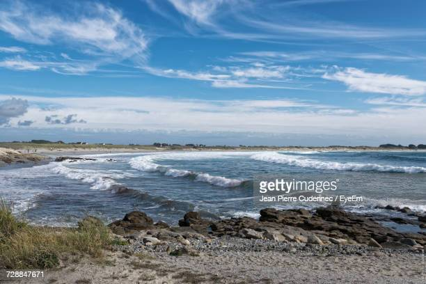 Scenic View Of Beach And Sea Against Sky