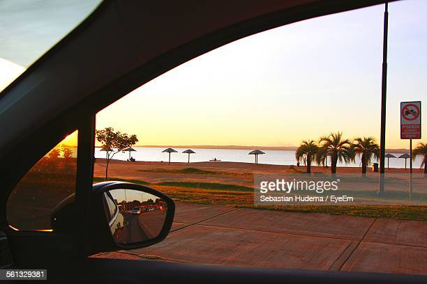 Scenic View Of Beach Seen From Car Window