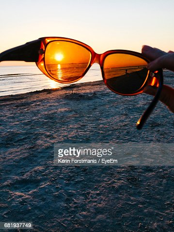 Scenic View Of Beach Through Sunglasses Against Clear Sky