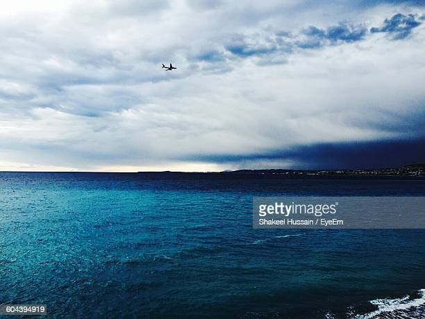 Scenic View Of Blue Sea Against Cloudy Sky