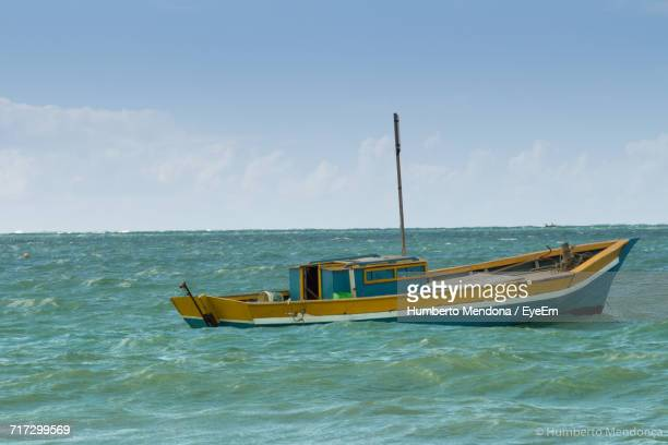 Scenic View Of Boat Sailing In Sea Against Sky