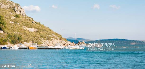 Scenic View Of Boats In Sea Against Sky
