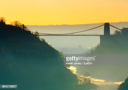 Scenic View Of Bridge Over Rain Against Sky During Sunset