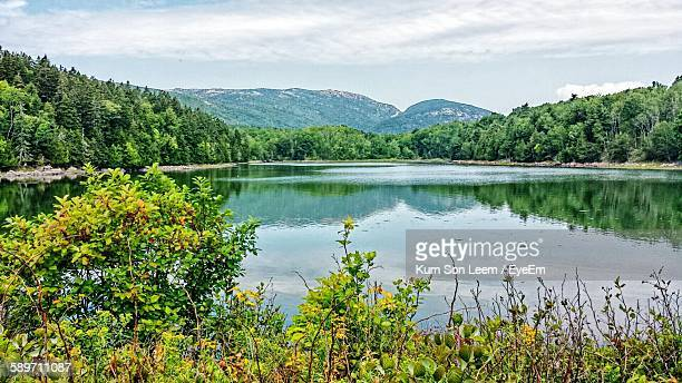 Scenic View Of Calm Lake And Mountains