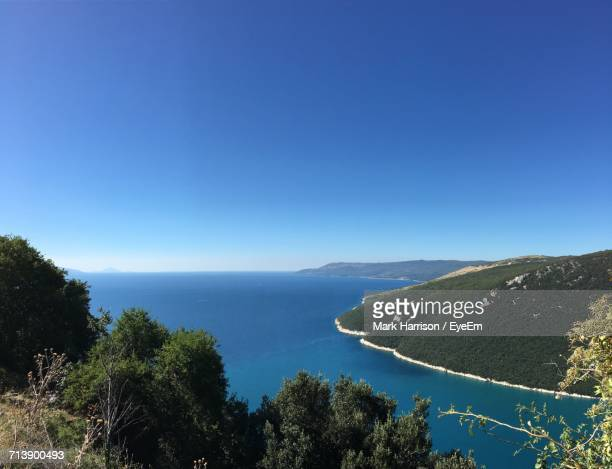 Scenic View Of Calm Sea Against Clear Blue Sky