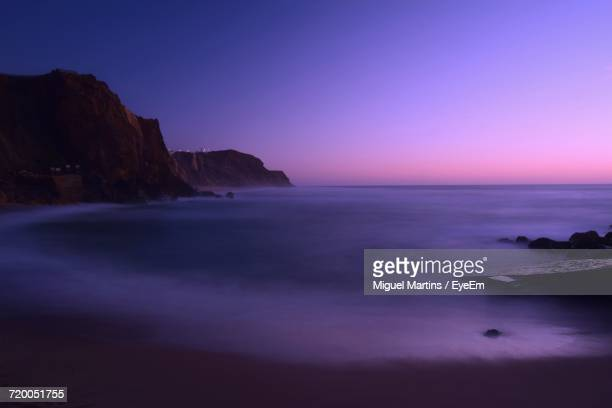 Scenic View Of Calm Sea At Dusk