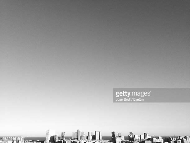 Scenic View Of Cityscape Against Clear Sky