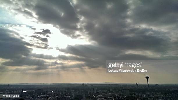 Scenic View of Cityscape Against Cloudy Sky