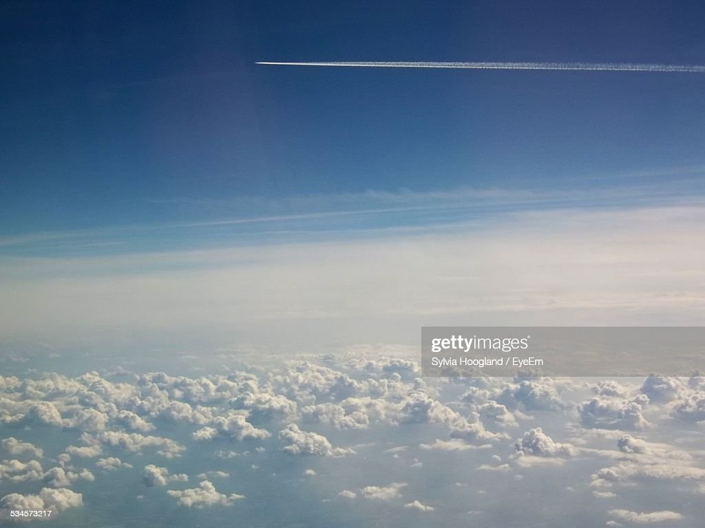 Scenic View Of Clouds Against Vapor Trail
