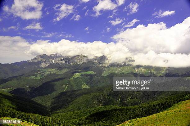 Scenic View Of Clouds Casting Shadow Over Mountain