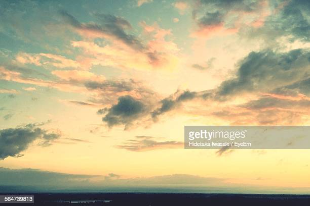 Scenic View Of Cloudy Sky Over Sea During Sunrise