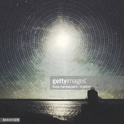 Scenic View Of Concentric Star Trails Over Sea At Night