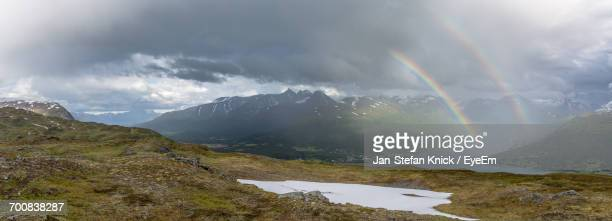 Scenic View Of Double Rainbow Over Hamperokken Mountains Against Cloudy Sky
